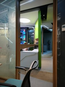 Reception area seen from enclosed office